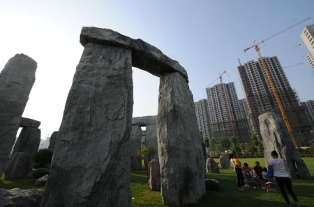 Hefei Stonehenge with high rise backdrop (STR/AFP/GettyImages)
