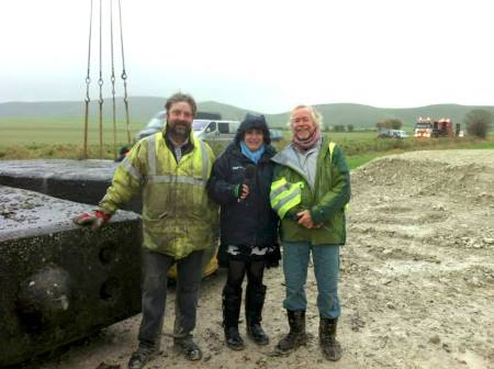 Timothy Daw, BBC Wiltshire's Karen Gardner, and Julian Richards with the concrete uprights
